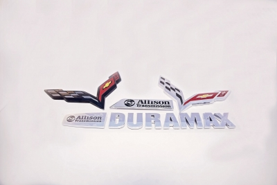 Part Name: Chevy Corvette Emblem<br>Tool Info: 1+1 Production Mold<br>Resin: Chrome Plateable ABS<br>&<br>Part Name: Duramax Badge<br>Tool Info: 1+1 Cavity Mold<br>Resin: ABS