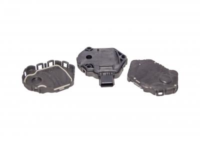 Part Name: Automotive Sensor Housing 2 Shot<br>Tool Info: Prototype Mold<br>Resin: PBT/TPE